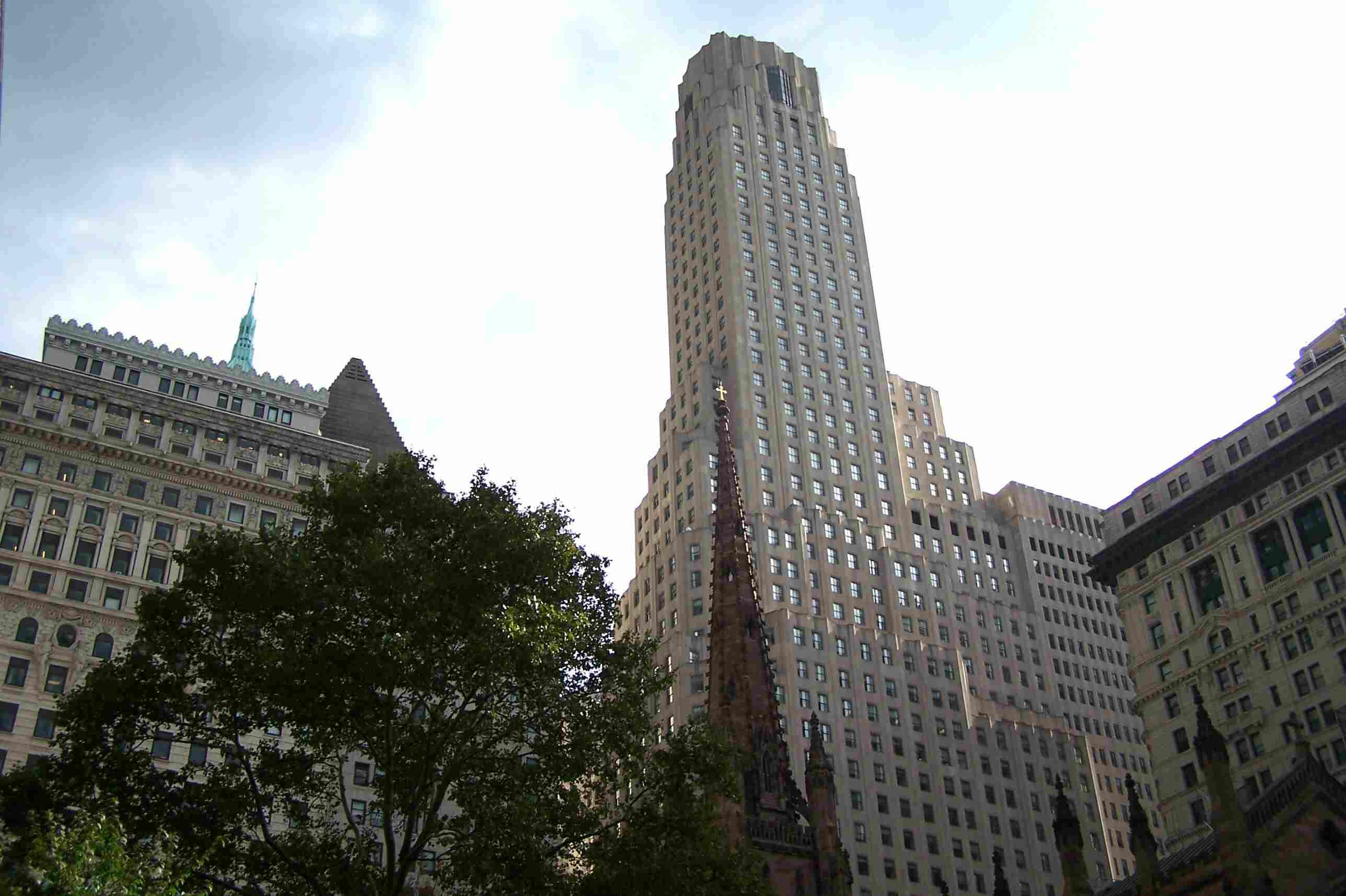 Steplike setbacks on One Wall Street as seen from behind Trinity Church.
