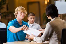 College student interviews at job fair.
