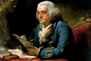 Painting of Benjamin Franklin wearing bifocals reading a document.