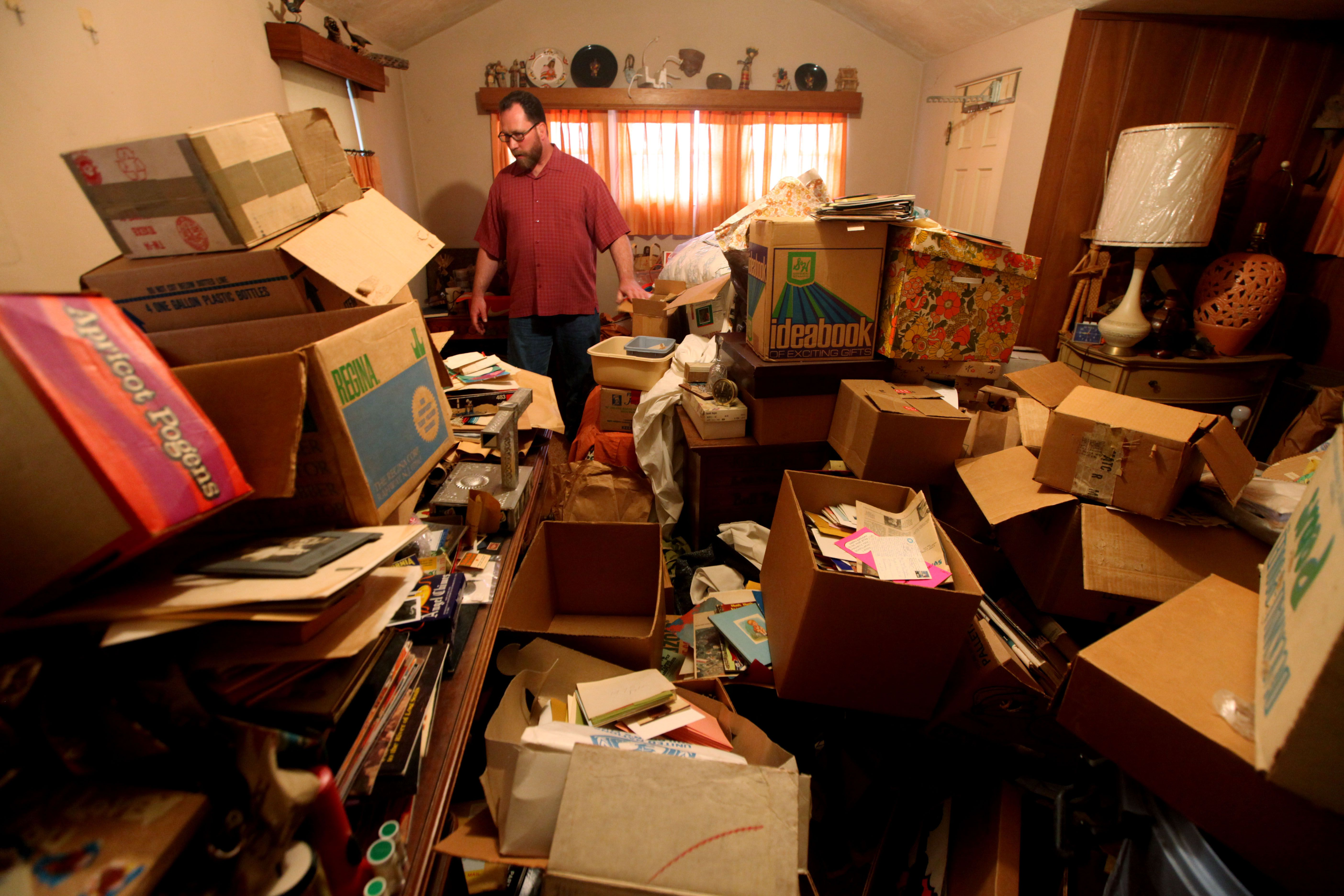 A son prepares to clean out his mother's cluttered home