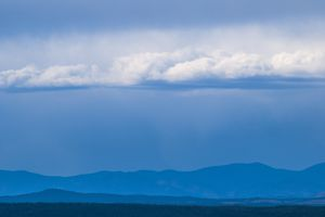 Rain clouds and rain in the Rocky Mountains over Colorado
