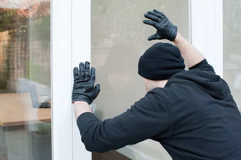 burglar lurking at home window