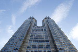 Tokyo skyscraper, 48 floors, two-towered design, postmodern coloring