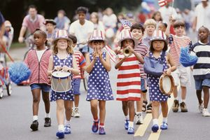 Group of children marching in 4th of July parade
