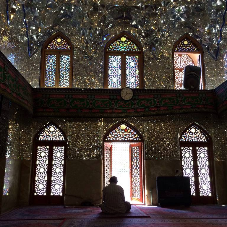 Rear View Of Man Praying In Imamzadeh-Ye Ali Ebn-E Hamze
