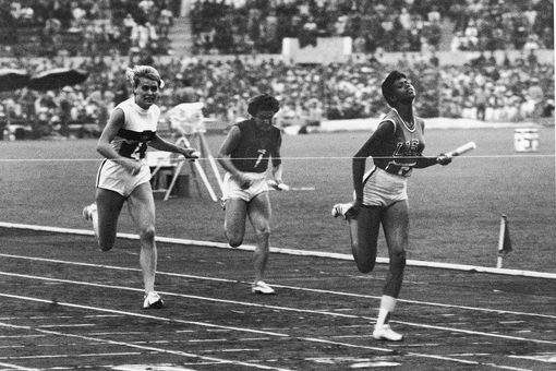 U.S. track star Wilma Rudolph crossing the finish line as she wins gold for the 4 x 100m relay.