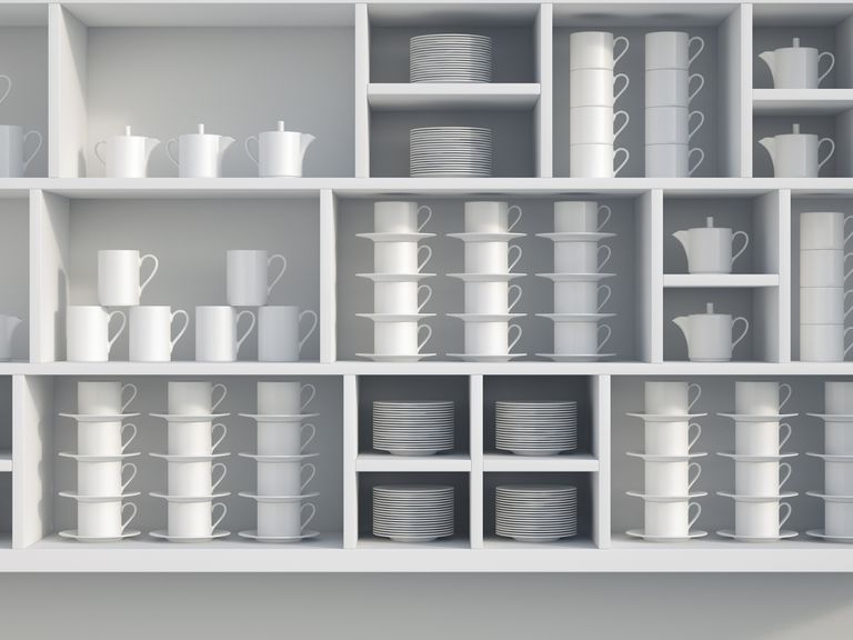 White, organized dishes in a cabinet