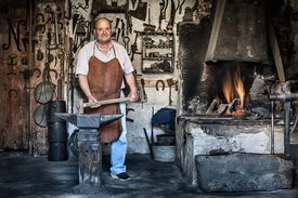 Blacksmith and forge at work.