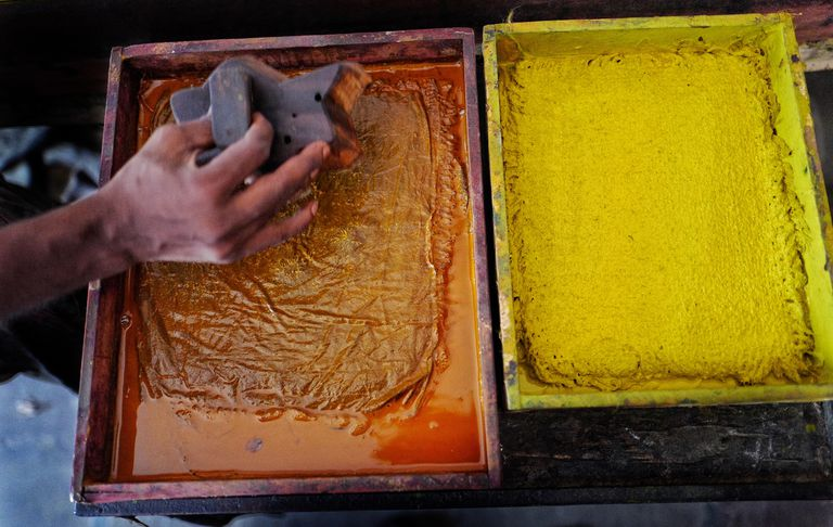 Stamp being coated in paint