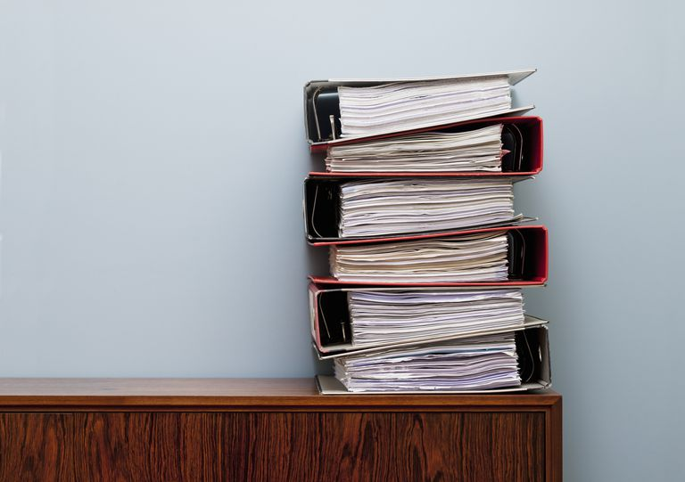 stacks of binders on a desk