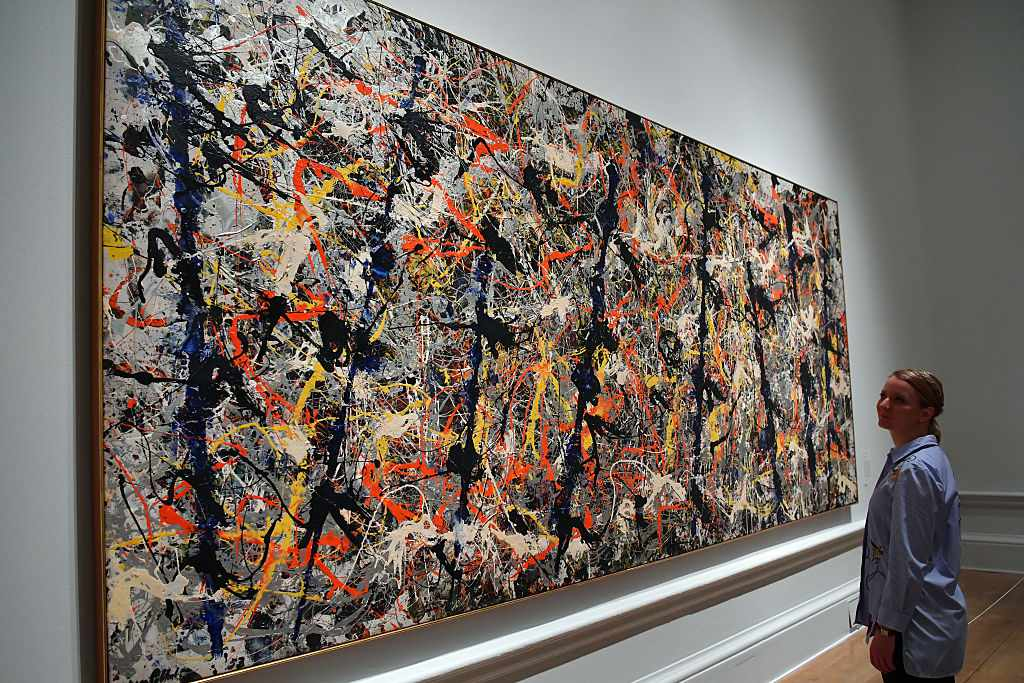 A museum employee in front of Jackson Pollock's Blue Poles