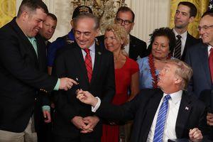 Trump handing over a bill signing pen