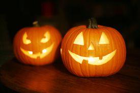 Two Jack-o-lanterns, a common Halloween decoration.