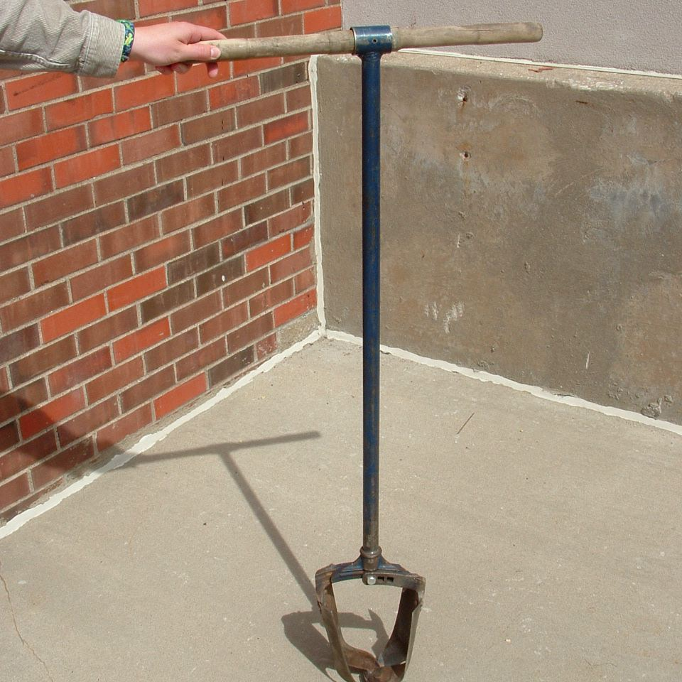 A bucket auger is used for testing deeply buried deposits