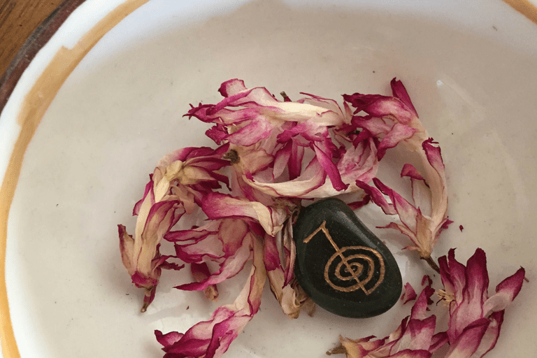 Flowers ad Reiki stone in a bow.