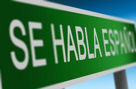 sign in spanish