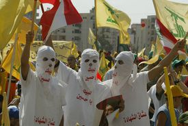 Hezbollah supporters wave flags during a ''Victory over Israel'' rally in Beirut's suburbs on September 22, 2006 in Beirut, Lebanon