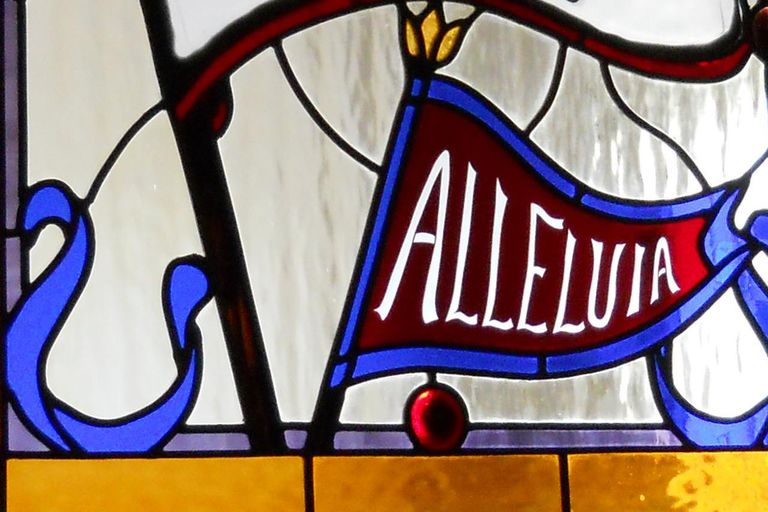 Alleluia memorial window between nave and narthex.