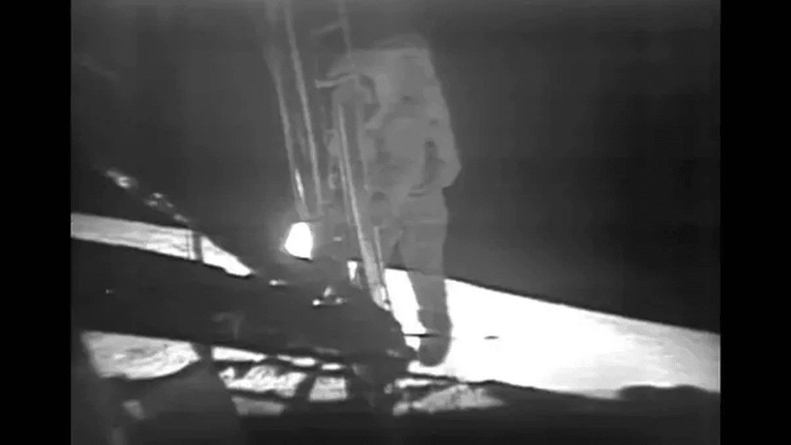 Neil Armstrong stepping onto the Moon.