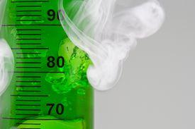 Smoke next to a tube full of green gel