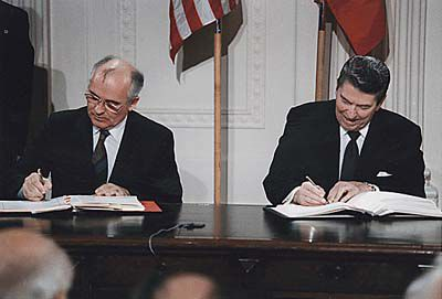 Picture of President Reagan and General Secretary Gorbachev signing the INF Treaty.