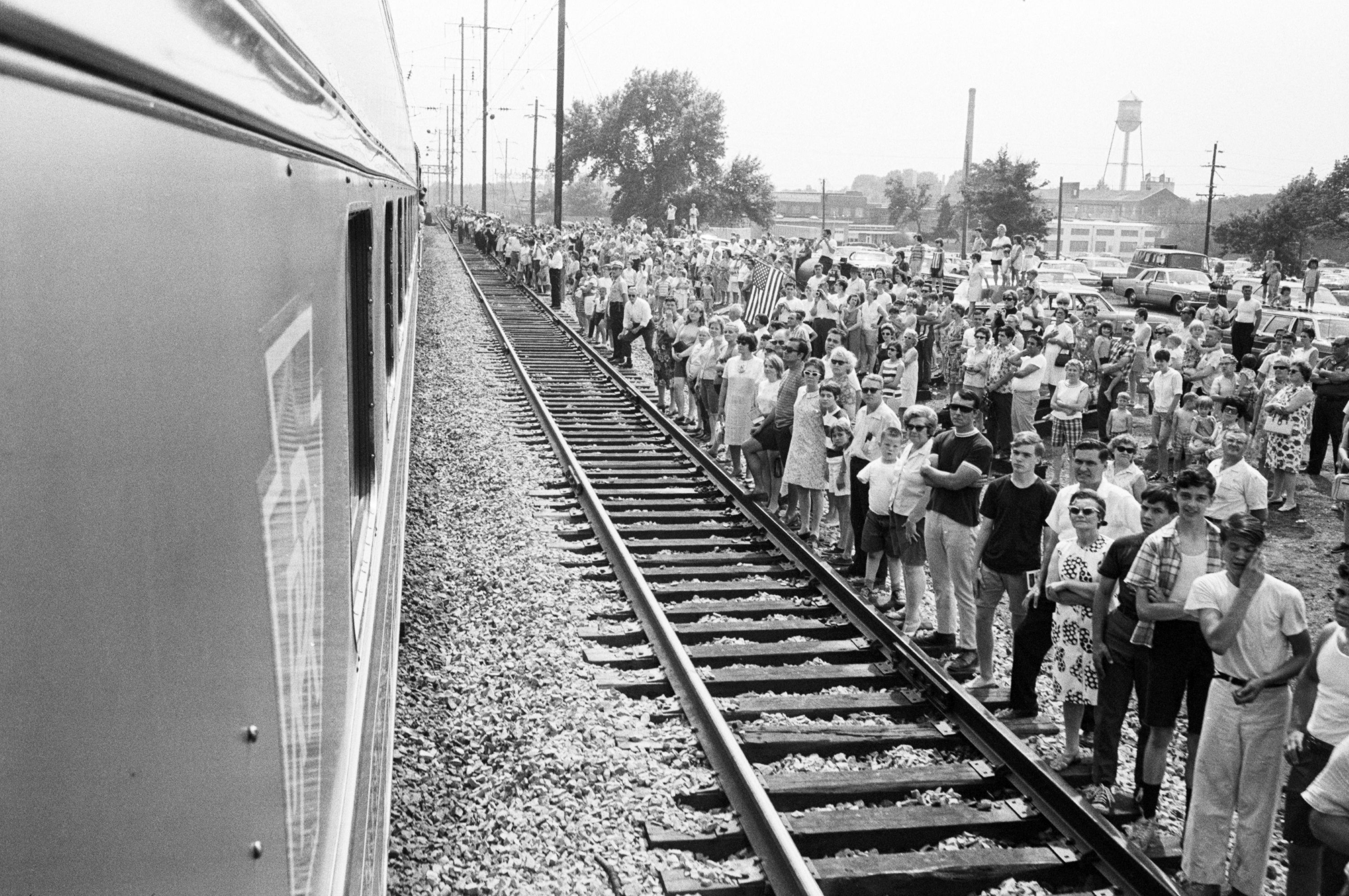 Crowds watching funeral train of Robert F. Kennedy