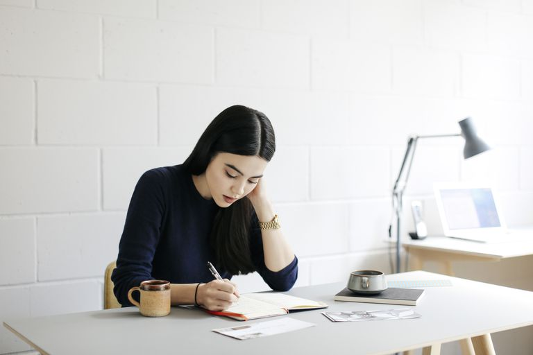 young woman taking notes