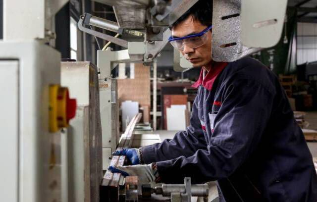 An employee working on aluminium products at a factory in Zouping in China's eastern Shandong province
