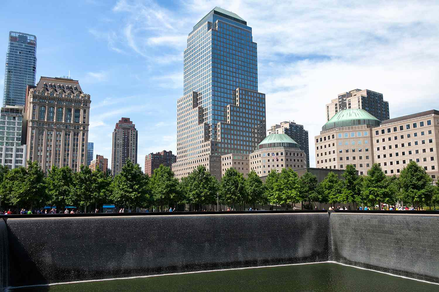 View of buildings and National September 11 Memorial in the island of Manhattan in New York, United States 2016.
