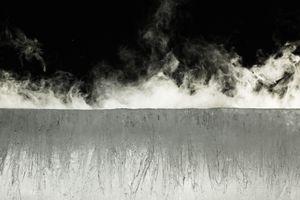 Water vapor rising from block of ice