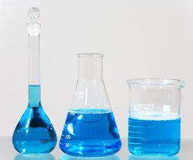 Beakers with blue liquid