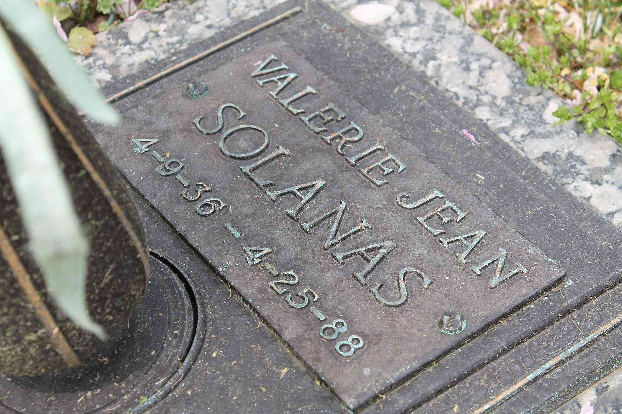 Plaque marking the grave of Valerie Solanas with her name and dates