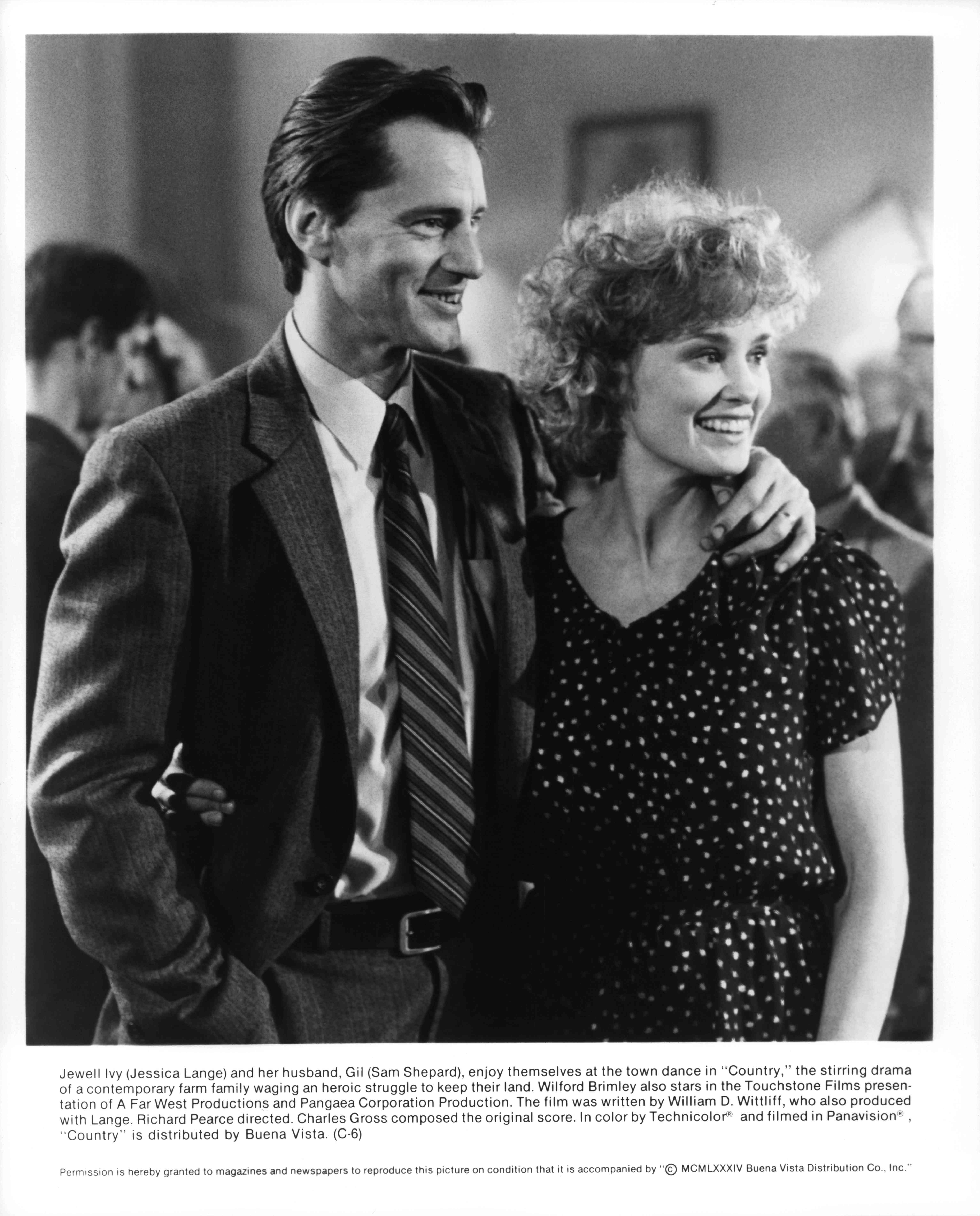 Sam Shepard and Jessica Lange, arms around each other, in a movie still