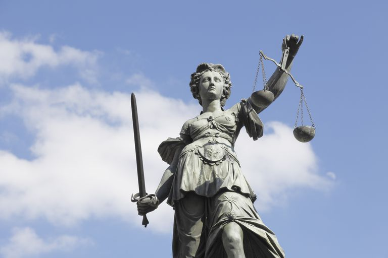Lady Justice statue carrying scale and sword.