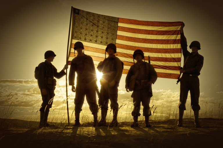 Silhouette of soldiers with American flag