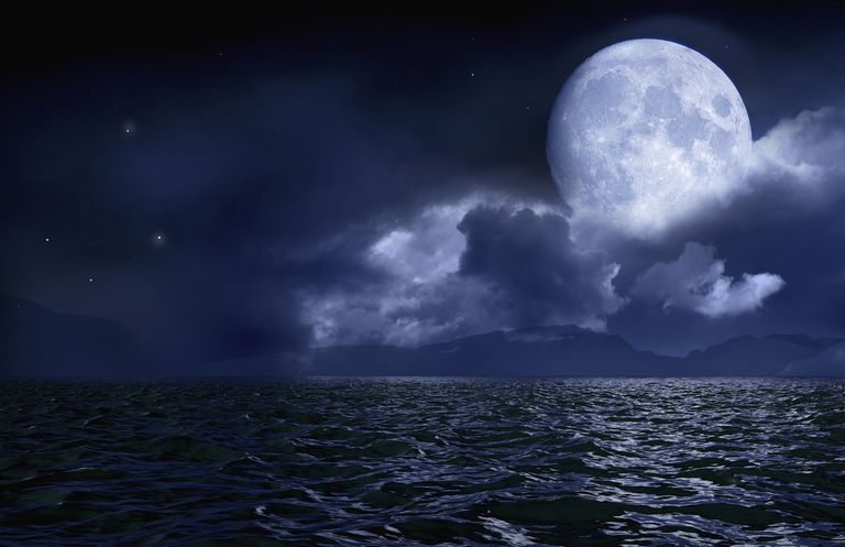 Full moon over seascape and horizon