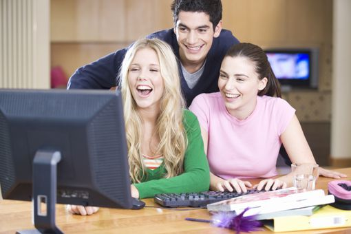 college kids looking at computer