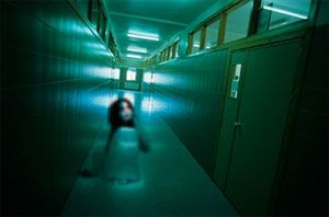 Ghost of a child in a school hallway