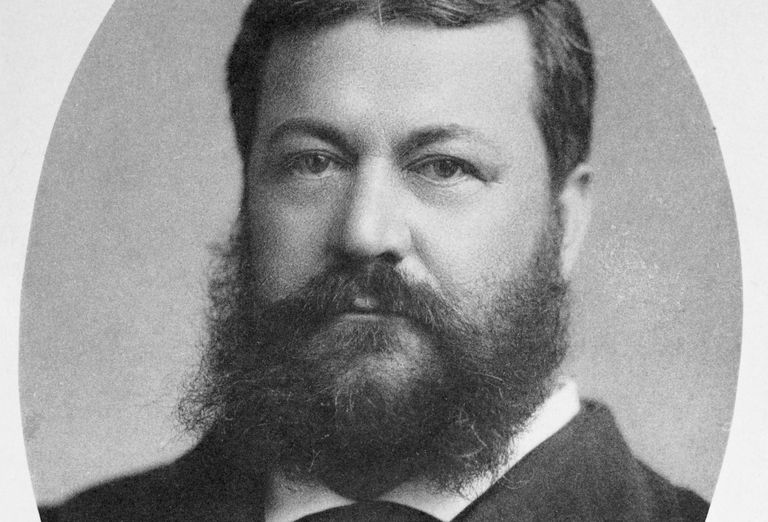 Black and white historic head portrait of bearded, rotund American architect Henry Hobson Richardson