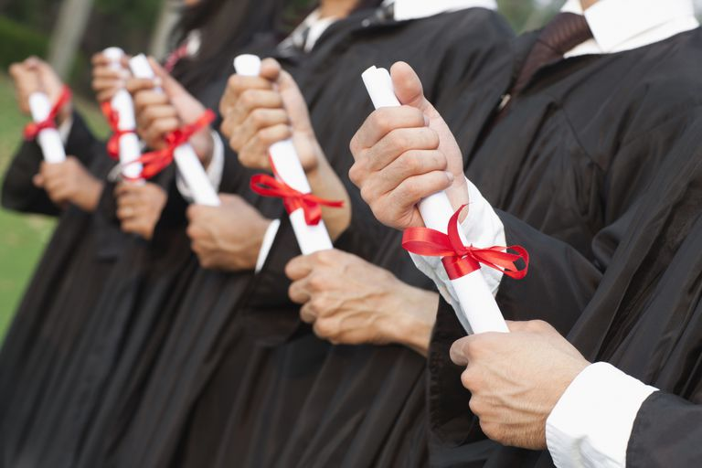 Hands gripping diplomas