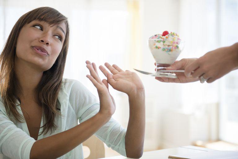 Woman refusing unhealthy ice cream