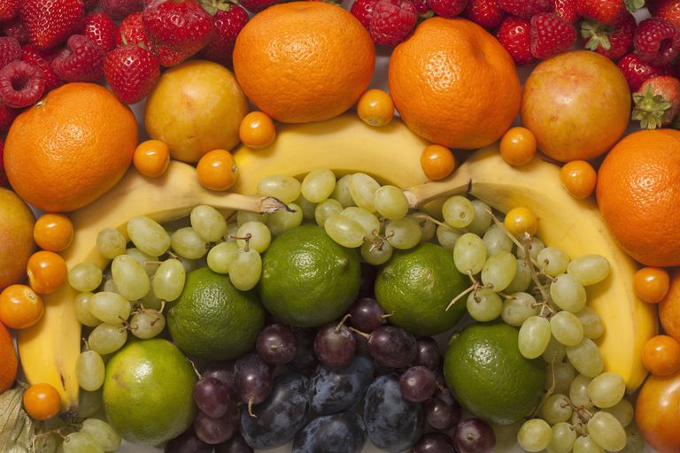 An abstract arrangement of various fresh fruits, full frame