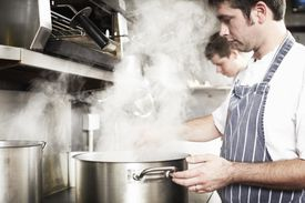 Adding salt to water increases its boiling point, but you'd have to add a lot of salt to make a difference when cooking.