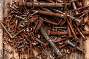 Collection of oxidized—rusty—bolts and nuts .
