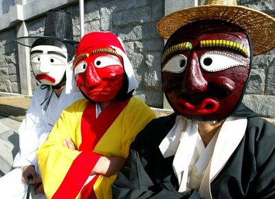 Young Aristocrat, Monk, and Servant: Korean mask-dancers.