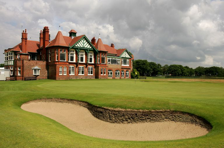 18th green and clubhouse at Royal Lytham & St. Annes golf course.