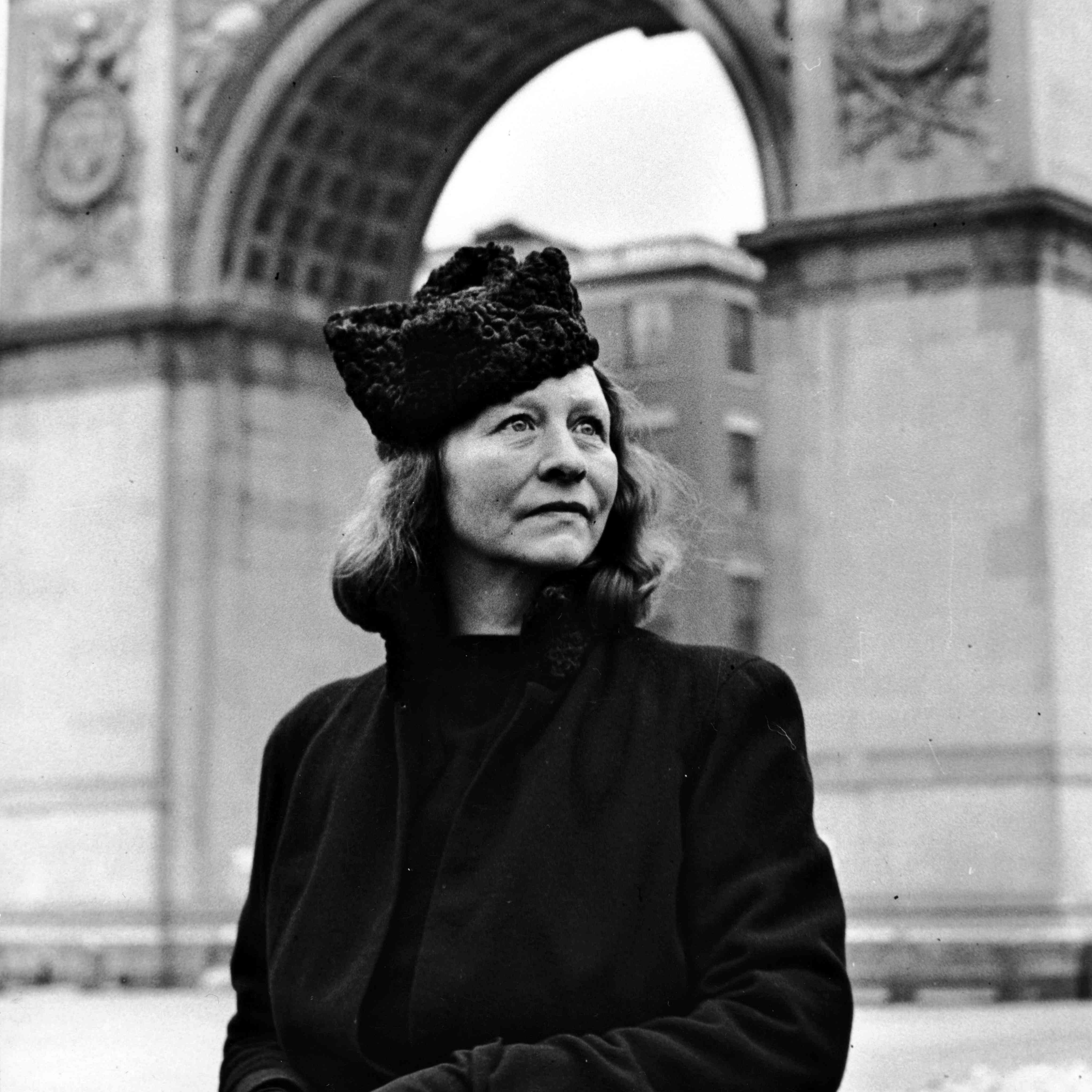 Edna St. Vincent Millay is standing in Washington Square Park in Greenwich Village, New York City, in 1941.
