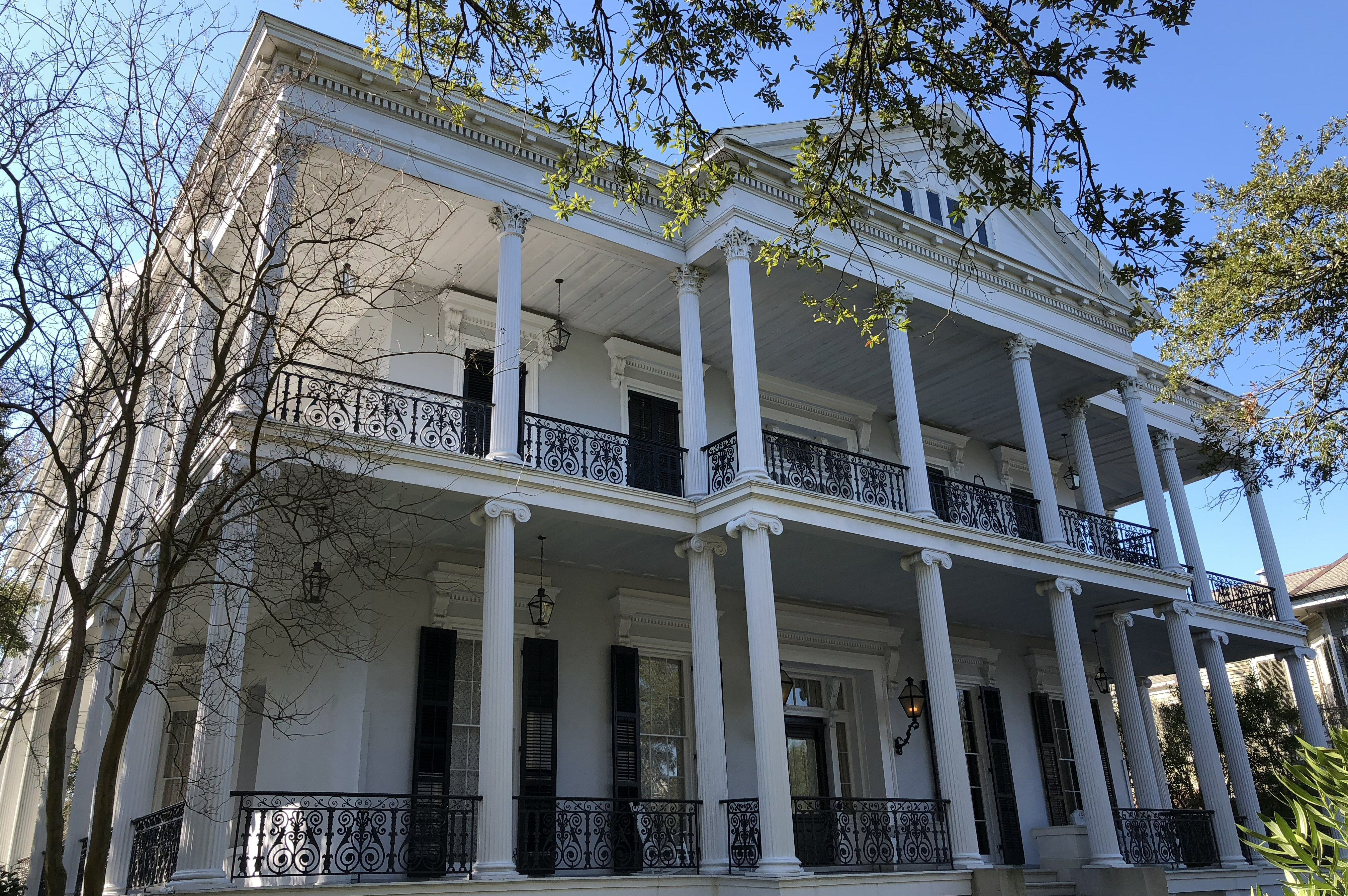 two story grand house with two porches with columns