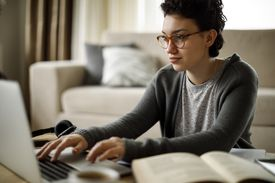 Young woman working at home