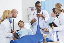 A doctor training medical students.